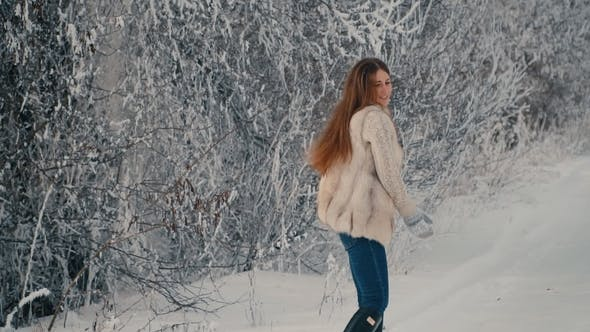 Thumbnail for Girl Playing with Snow