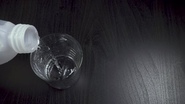 Water Pouring From a Plastic Canister