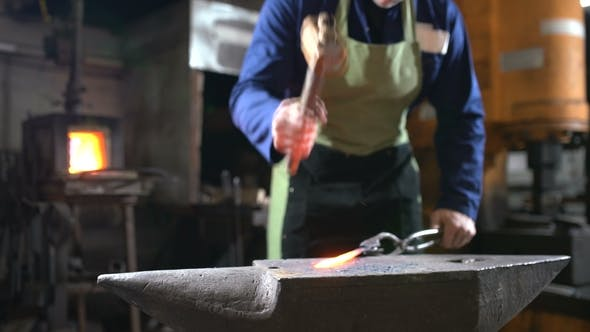 Thumbnail for The Blacksmith Forges the Luminous Metal in the Furnace, Kicks Out the Sparks