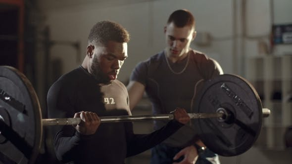 Thumbnail for Black Man Working Out with Personal Trainer