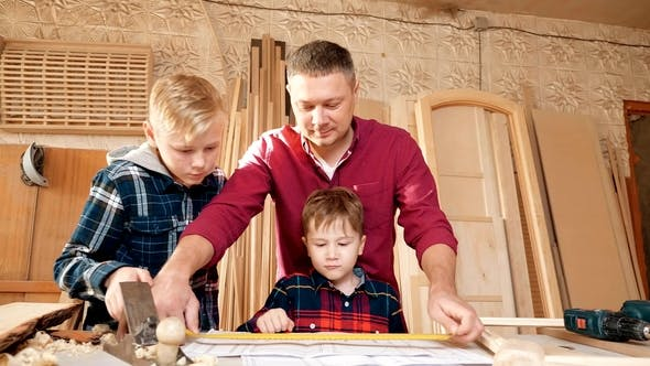 Thumbnail for Family, Carpentry, Woodwork and People Concept Father Teaches Son Carpentry
