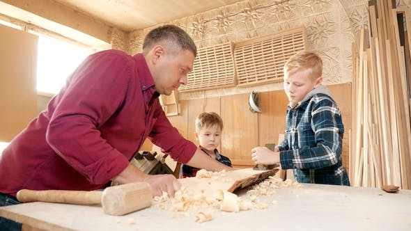Thumbnail for Family, Carpentry, Woodwork and People Concept. Father Teaches Son Carpentry.