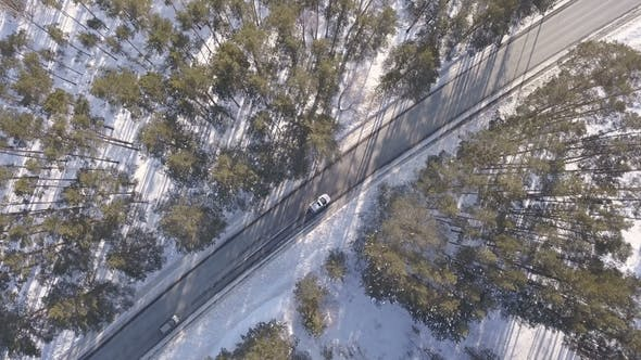 Thumbnail for Snowy Road with a Moving Cars in Winter