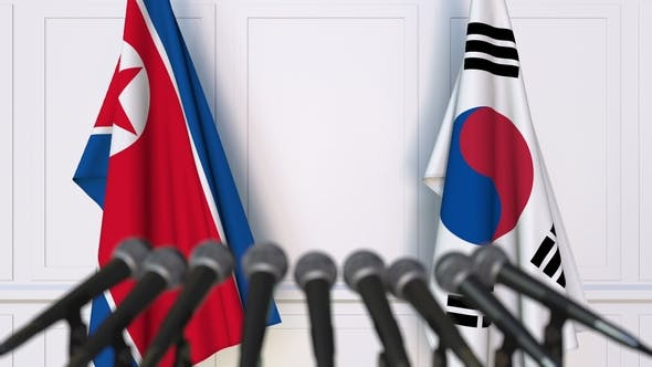Thumbnail for Flags of North Korea and Korea at International Press Conference