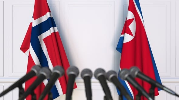Thumbnail for Flags of Norway and North Korea at International Press Conference