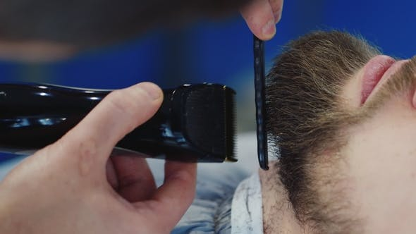 Thumbnail for Men's Hairstyling and Haircutting in a Barber Shop or Hair Salon. Grooming the Beard. Barbershop.