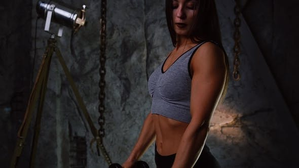 Thumbnail for Sexy Sporty Girl with a Beautiful Booty and Inflated Press with Dumbbells