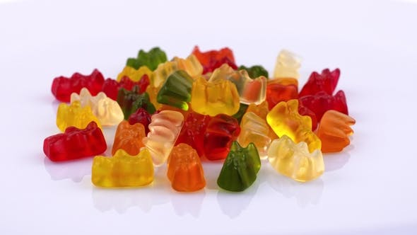 Thumbnail for Gummy Bears, Sweet Fruit Jelly Candies. Rotating on Turntable. Isolated on White Background.