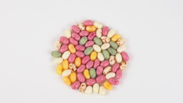 Cover Image for Top View Rotating Jelly Beans Candies Isolated on White.