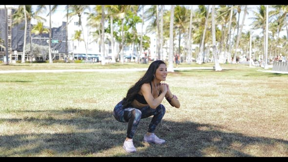 Thumbnail for Content Sportive Girl Squatting in Park