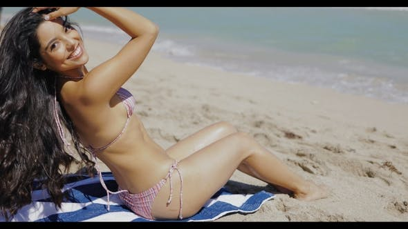 Thumbnail for Beautiful Fit Girl in Bikini Sitting on Sand