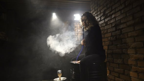 Thumbnail for Attractive Girl is Smoking a Hookah