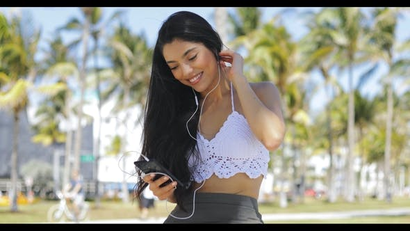 Cover Image for Stylish Content Girl with Phone Outside