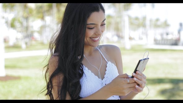 Thumbnail for Pretty Ethnic Woman Using Phone Outside