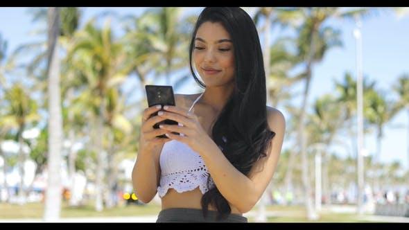 Thumbnail for Stylish Brunette Using Smartphone in Park