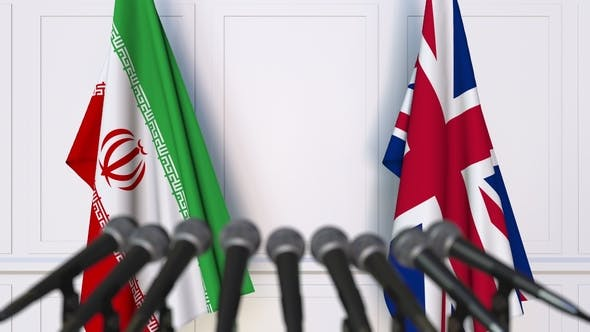 Thumbnail for Flags of Iran and The United Kingdom at International Press Conference