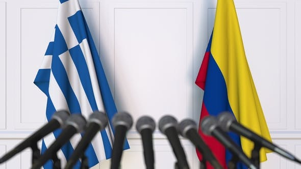 Thumbnail for Flags of Greece and Colombia at International Press Conference