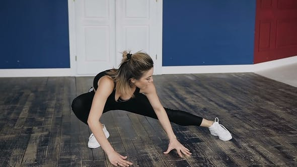 Thumbnail for Beautiful Young Girl Working Out Indoors Dressed Black Sport Body, Doing Yoga Exercise in the Room