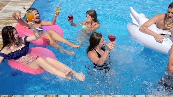 Thumbnail for Party in Pool Luxurious Life of Friends with Colored Cocktails Swim on Inflatable Rings Into