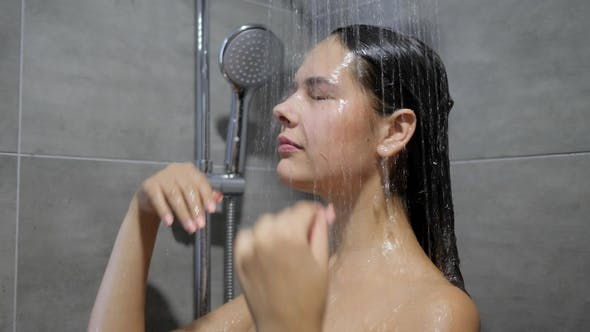 Thumbnail for Young Woman Washes Long Hair under Running Water and Enjoying Shower