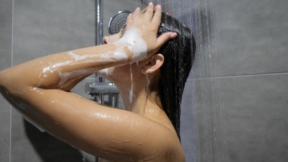 Thumbnail for Body Care Female Stands Under Running Water and Washes Long Hair Under Shower