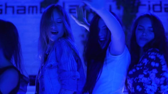 Thumbnail for Attractive Girls Dance Close Together on Dance Floor Friends at Party