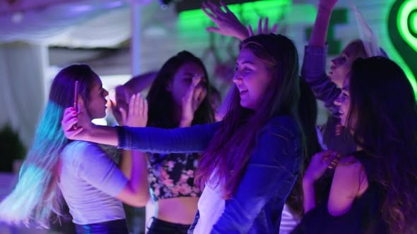 Thumbnail for Female Company Friends Makes Photo and Record Video on Android in Fashionable Night Club