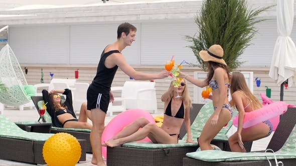 Thumbnail for Party in the Pool Group Young People in Swimsuits on Chaise-longue with Colored Beverages