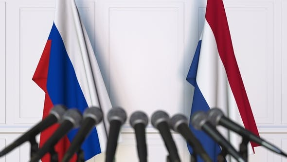Thumbnail for Flags of Russia and Netherlands at International Press Conference