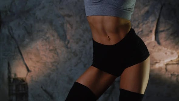 Fitness Model Moves in Front of Cam