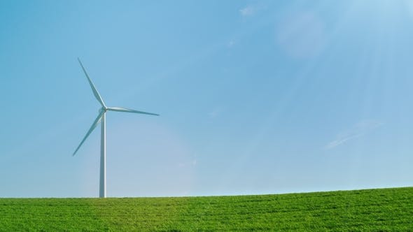 Thumbnail for An Idyllic Picture of Pure Energy - a Wind Generator on a Green Hill in the Rays of the Sun