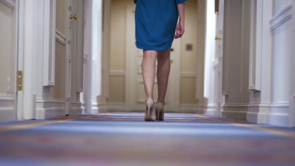 Thumbnail for Female Feet in High Heeled Shoes Walking Along Corridor in Guest Hotel Back View