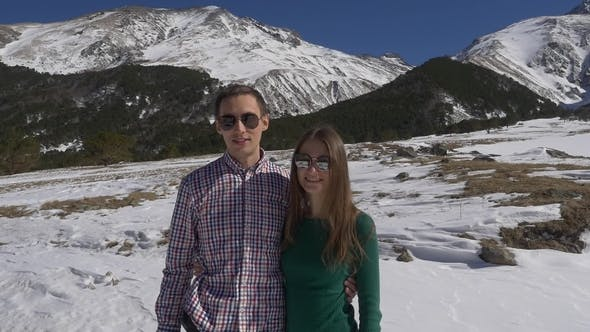 Couple of Young Newlyweds in the Mountains on a Honeymoon