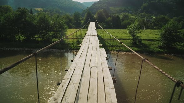 Thumbnail for Tension Rope Bridge with Wooden Decking Over the Mountain Stream