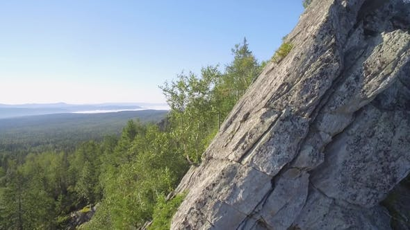 Thumbnail for Fir, Birch and Pine Tree Forest Over Rocks Seen From Above, Camera Up. Beautiful Summer Landscape