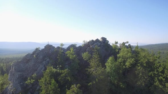 Thumbnail for Fir, Birch and Pine Tree Forest Over Rocks Seen From Above. Beautiful Summer Landscape with Rock and