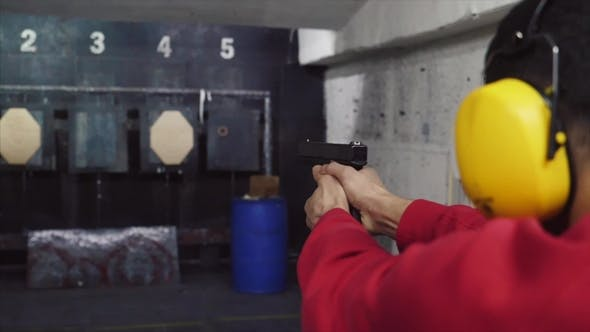 Thumbnail for Shoot in Dash From Pistol. A Man Shoots a Gun in the Dash