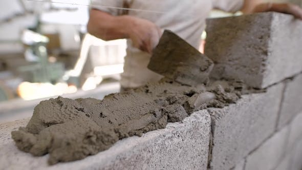 Thumbnail for Bricklayer on a Construction Site with a Trowel