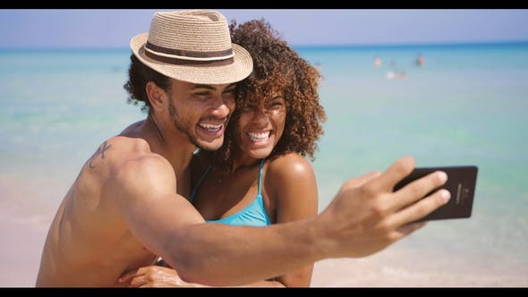 Thumbnail for Cheerful Happy Couple Selfies on Beach