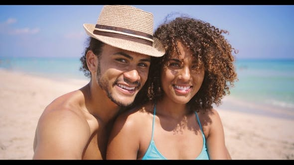 Thumbnail for Couple Looking at Camera on Beach