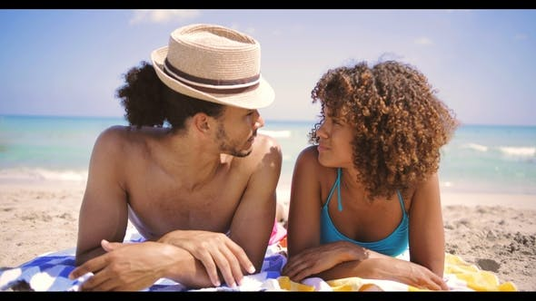 Cover Image for Couple Lying at Each Other on Beach
