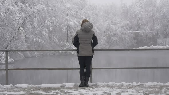 Thumbnail for Lonely Woman Near the Lake in Winter