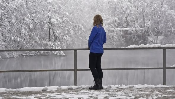 Thumbnail for Girl Is Standing on the Shore of a Winter Lake