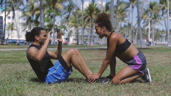 Thumbnail for Woman Helping Exercising To Man