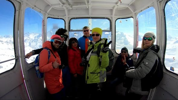 Thumbnail for Group of Tourists Inside the Gondola of Cableway