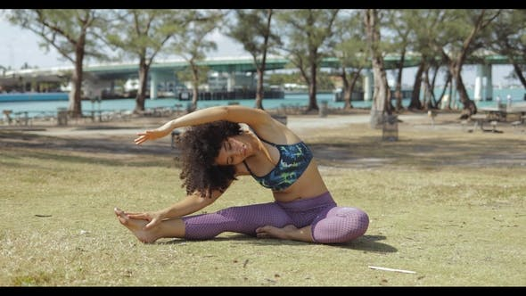 Thumbnail for Concentrated Young Girl Stretching Body on Lawn
