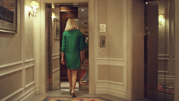Thumbnail for Young Woman Coming Into Elevator Car and Lift Doors Closing