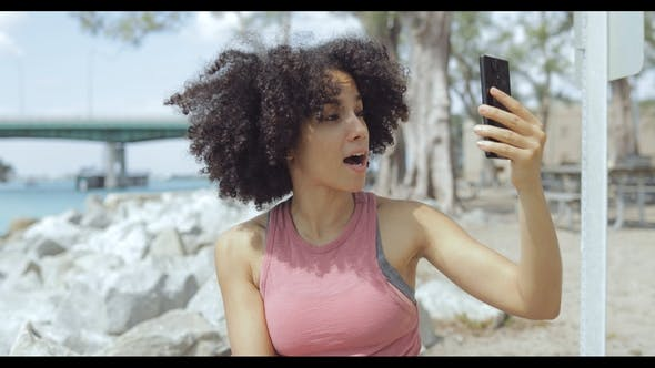 Thumbnail for Young Girl Using Phone for Selfie on Riverside