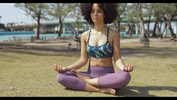 Thumbnail for Relaxed Meditating Woman on Green Lawn
