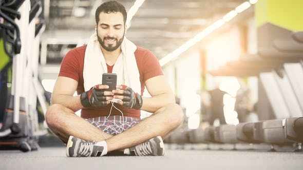 Thumbnail for Man with Phone in Gym